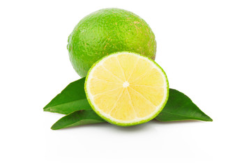 Fresh lime with green leaves isolated on white background