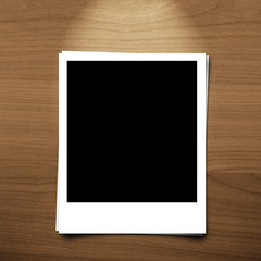 blank photo frame on brown wood background with lighting lamp