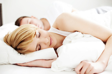 Portrait of couple sleeping in the bed