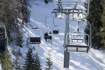 Chair Lift for skiers in Dolomites in winter time