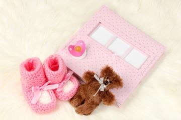 Baby photo album on white carpet