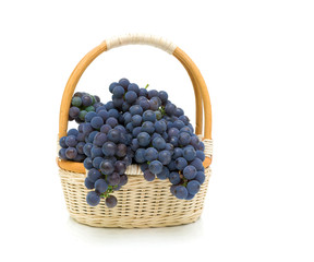 basket with grapes on a white background close-up