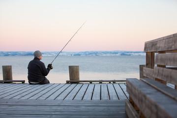 Fototapeta sitzender Angler #3