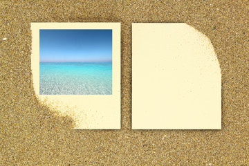 Photo frame and paper card on the sand