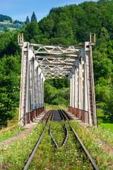 metal bridge in mountains