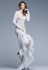 Keuken foto achterwand Artist KB beautiful woman in long white dress posing fashion in the studio