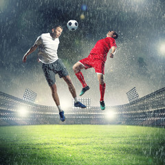 Canvas Prints Football two football players striking the ball