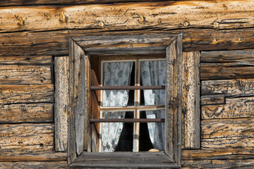 Old wood cabin house window