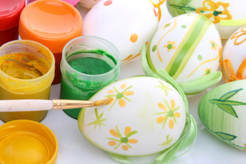 Painting colorful Easter eggs