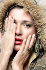 Beauty Woman in Camouflage Hoodie. Winter season