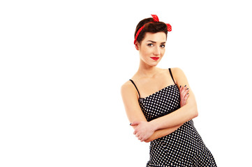Woman in Pin-up style on white background smiling