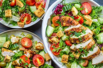 Three healthy salads with fresh vegetables
