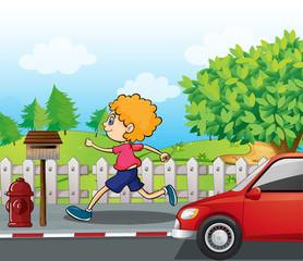 A boy running near the wooden mailbox