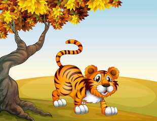 A tiger in a jumping position near the big tree