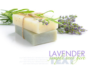 Handmade soap and lavender flowers on a white background