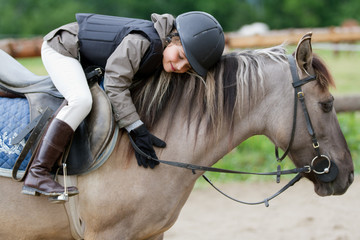 Photo sur cadre textile Equitation Horse riding - lovely equestrian on a horse