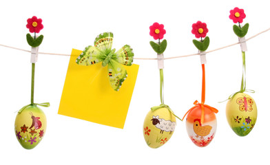 Easter eggs hanging on a string