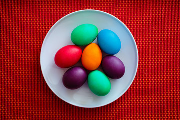 Colorful easter eggs on white plate