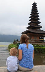 family looking at water temples in Bali