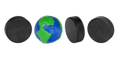 Hockey pucks and plasticine globe