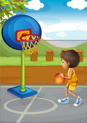 A little boy playing basketball