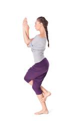 Young woman doing yoga exercise Garudasana eagle pose isolated o