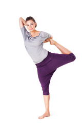 Young woman doing yoga exercise Natarajasana (Lord of the Dance