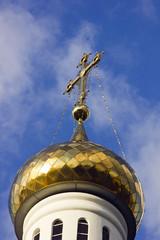 Golden cross over church