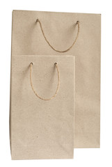 Recycled paper bags with hemp rope handles isolated on white