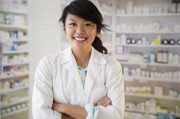 Pacific Islander pharmacist standing in pharmacy