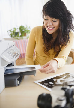 Pacific Islander making photocopies