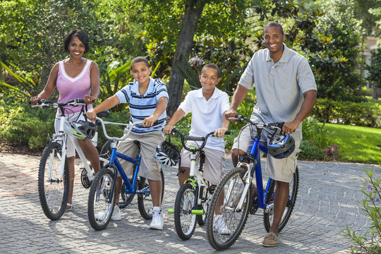 African American Parents Boy Children Riding Bikes
