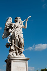 Wall Mural - Statue at Sant Angello bridge on blue sky at Rome