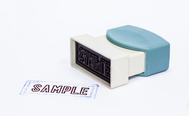 Stamper imprint the sample word on the white background