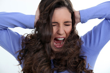 Angry woman with curly hair