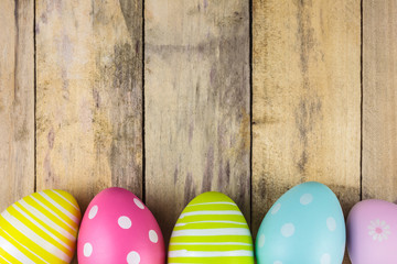 Dyed easter eggs on a wooden background