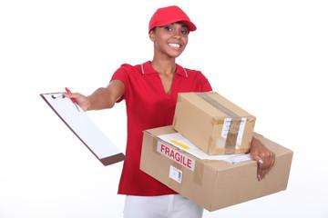 Young courier delivering parcels
