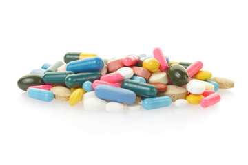 Pill and colorful capsule heap on white, clipping path