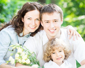Happy family with spring flowers