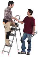duo of craftsmen shaking hands