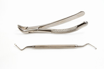 dentist extraction forceps and dental equipment on white backgro