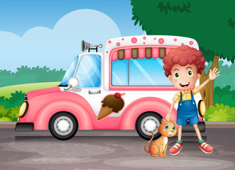 A boy and his cat near a pink bus
