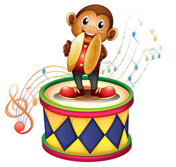 A monkey above a drum with cymbals