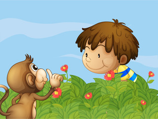 A monkey and a boy talking at the garden