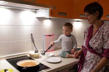Mother with toddler at kitchen