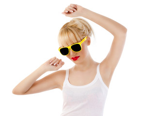 Young blonde woman dancing against white background