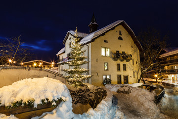 Fototapete - Village of Megeve on Christmas Illuminated in the Night, French