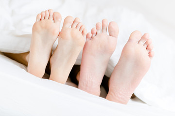 Close up of two pairs of feet of the couple next to each other