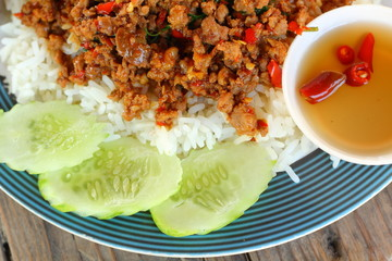 Rice topped with fried pork and basil