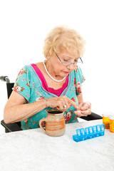 Disabled Senior Examining Her Medication
